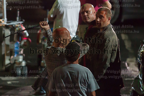 US actor Bruce Willis (L) and Australian actor Jai Courtney (2nd R) participate a rehearsal of a fight schene on set during a shooting of their next movie fifth in the Die Hard series titled Good Day to Die Hard in Budapest, Hungary on July 11, 2012. ATTILA VOLGYI