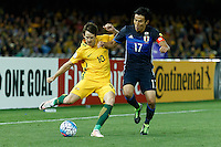 October 11, 2016: ROBBIE KRUSE (10) of Australia kicks the ball as MAKOTO HASEBE (17) of Japan tries to block the kick during a 3rd round Group B World Cup 2018 qualification match between Australia and Japan at the Docklands Stadium in Melbourne, Australia. Photo Sydney Low Please visit zumapress.com for editorial licensing. *This image is NOT FOR SALE via this web site.