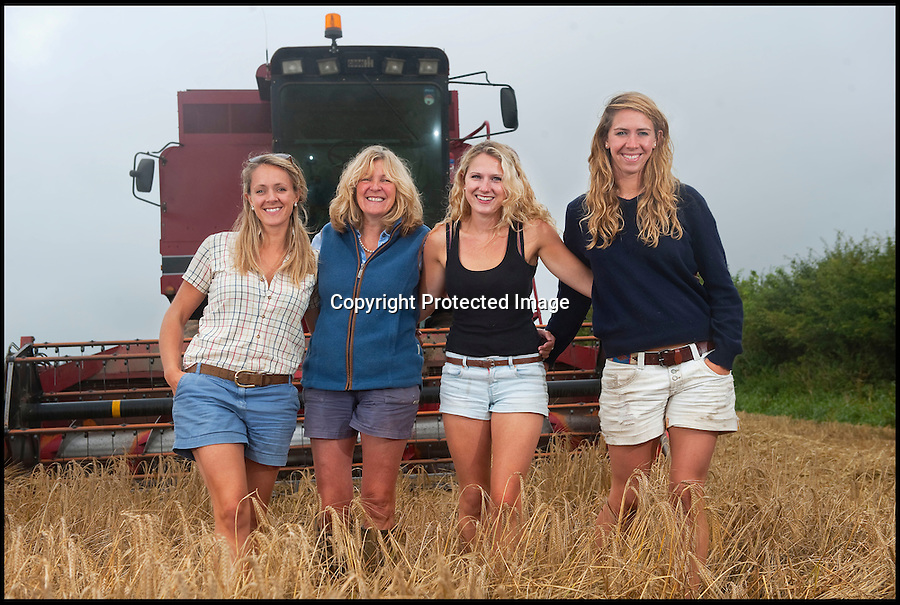 BNPS.co.uk (01202 558833)<br /> Pic: PhilYeomans/BNPS<br /> <br /> L-r Georgina (28), Carol (52), Katy (21) and Harriet (25)<br /> <br /> Far from the Madding Crowd - Land Girls...Plucky mum and her daughters running the family farm in the heart of Dorset.<br /> <br /> Widow Carol Besent is getting a bumper harvest in this year with the help of her three daughters Georgina, Harriet and Katy.<br /> <br /> Carol's husband died four years ago and rather than give up the family farm Carol and her daughters have taken the unusual step of running the 700 acre mixed arable and dairy farm themselves.