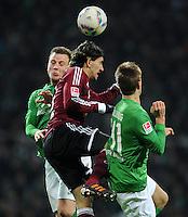 FUSSBALL   1. BUNDESLIGA   SAISON 2011/2012   23. SPIELTAG SV Werder Bremen - 1. FC Nuernberg                   25.02.2012 Philipp Bargfrede (li)  und Niclas Fuellkrug (re, beide SV Werder Bremen) gegen Almong Cohen (Mitte, 1. FC Nuernberg)