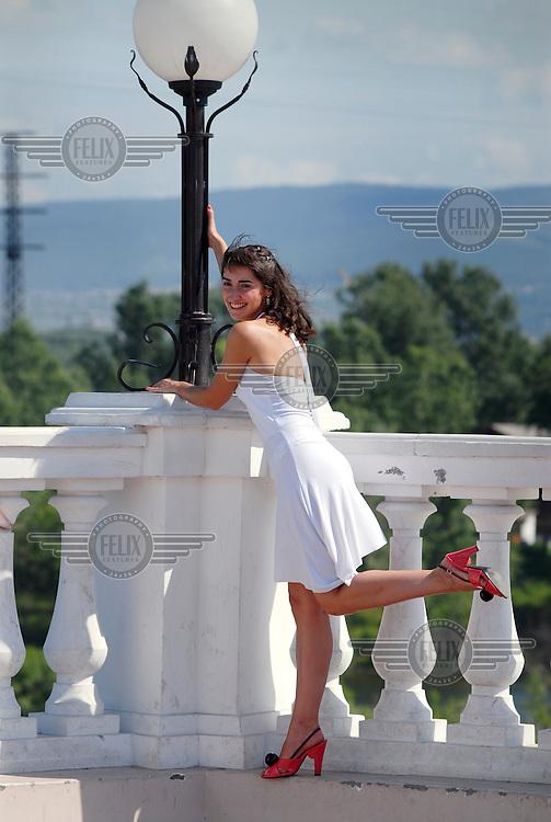 Wedding photographs are taken on a balcony in the city of Krasnoyarsk.
