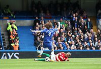 Pictured: Chico Flores with a sliding tackle on David Luiz<br />