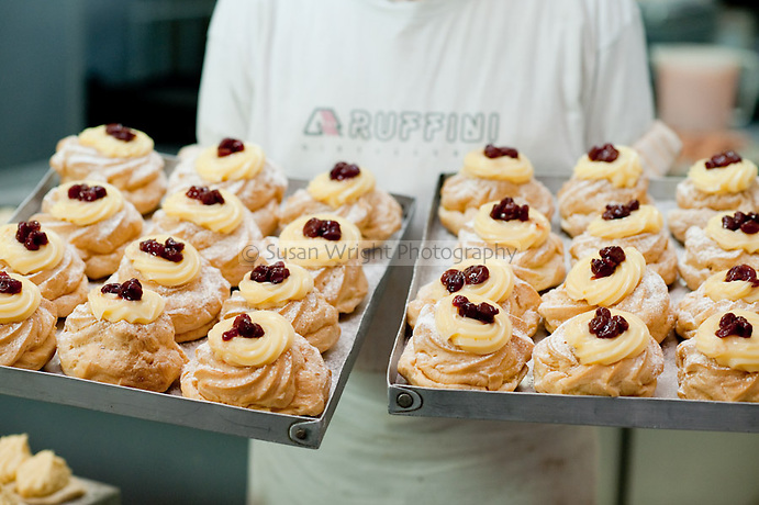 Freshly baked trays of 'Zeppole'  at 'Attanasio' a popular pasticceria in Naples, Italy