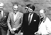 United States President Ronald Reagan, second right, and Prime Minister Pierre Elliott Trudeau, right, meet as part of the Ottawa Summit at the Château Montebello in Quebec, Canada on July 20, 1981.  European leaders are complaining about high US interest rates and have suggested the US stall the delivery of F-16 jets to Israel because of the violence in the Middle East.  From left to right: US Secretary of the Treasury Donald Regan, US Secretary of State Alexander Haig, unidentified, President Reagan, Prime Minister Trudeau.<br /> Credit: Arnie Sachs / CNP