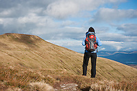 Female hiker takes in view of Pey Y Fan, Brecon beacons national park, Wales