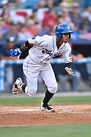 Asheville Tourists center fielder Manny Melendez (19) runs to first base during a game against the Charleston RiverDogs at McCormick Field on July 4, 2017 in Asheville, North Carolina. The Tourists defeated the RiverDogs 2-1. (Tony Farlow/Four Seam Images)