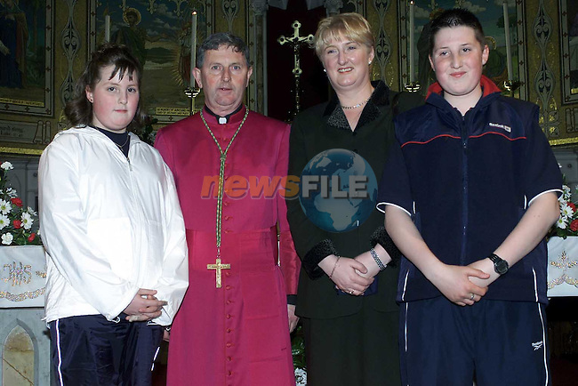 Sandra Floyd Monasterboice with her mother patricia and Sister Ultann and Bishop Michael Smith after confirmation in St Marys Church for Fatima school..Pic Fran Caffrey Newsfile..