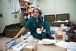 Imelda Donohue, a nurse on board the USNS Comfort, a naval hospital ship, organizes surgical supplies. The Comfort is on a mission to help survivors of the earthquake in Haiti on Monday, January 18, 2010 in the Atlantic Ocean off the coast of the United States.