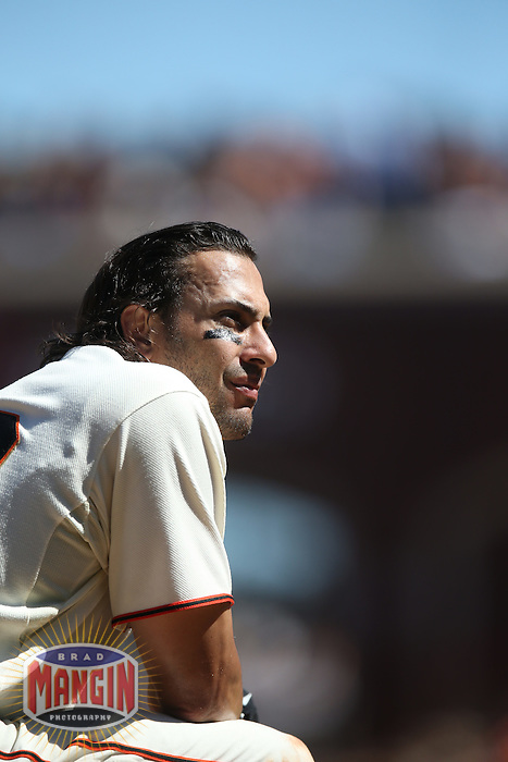 SAN FRANCISCO, CA - AUGUST 16:  Michael Morse #38 of the San Francisco Giants takes a break at third base during a pitching change against the Philadelphia Phillies during the game at AT&T Park on Saturday, August 16, 2014 in San Francisco, California. Photo by Brad Mangin