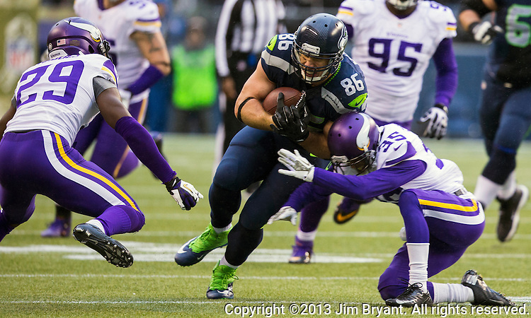 Seattle Seahawks tight end Zach Miller is brought down by Minneosta Vikings cornerback Marcus Sherels (35) after catching a pass against the Minnesota Vikings at CenturyLink Field in Seattle, Washington on  November 17, 2013.  The Seahawks beat the Vikings 41-20.  ©2013.  Jim Bryant. All Rights Reserved.