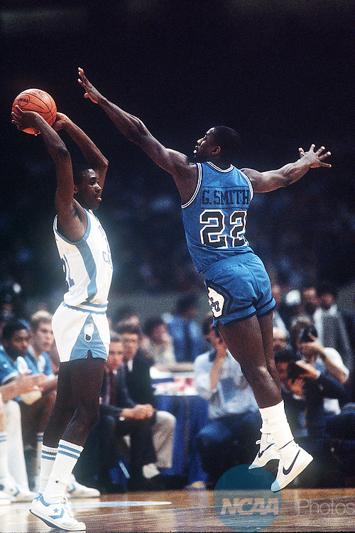Caption: 29 MAR 1982: University of North Carolina's Jimmy Black (21) looks to pass with pressure from Georgetown University's Gene Smith (22) during the NCAA National Basketball Championship game in New Orleans, LA Superdome. North Carolina defeated Georgetown 63-62 to win the title. Rich Clarkson/NCAA Photos Photographer: Rich Clarkson/NCAA PhotosTitle: M1K82CAG.jpgCity: New OrleansState: LACountry: USADate: 19820329Caption Writer: bgCategory: Sâ?¢