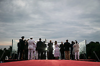 """U.S. President Donald Trump and first lady Melania Trump watch with U.S. Vice President Mike Pence and guests as military planes fly overheard during the Fourth of July Celebration 'Salute to America' event in Washington, D.C., U.S., on Thursday, July 4, 2019. The White House said Trump's message won't be political -- Trump is calling the speech a """"Salute to America"""" -- but it comes as the 2020 campaign is heating up. <br /> h<br /> CAP/MPI/CNP<br /> ©CNP/MPI/Capital Pictures"""