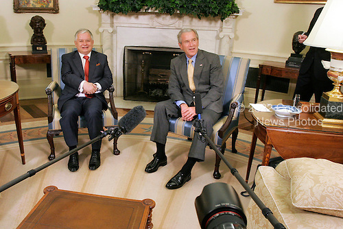 Washington, D.C. - July 16, 2007 -- United States President George W. Bush meets with President Lech Kaczynski of Poland in the Oval Office of the White House on Monday, July 16, 2007. .Credit: Ken Cedeno - Pool via CNP
