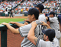 (F-B) Francisco Cervelli, Masahiro Tanaka, Ivan Nova, Ichiro Suzuki (Yankees),<br /> APRIL 1, 2014 - MLB :<br /> Francisco Cervelli of the New York Yankees gives his teammate Masahiro Tanaka a shoulder massage in the dugout during the baseball game against the Houston Astros at Minute Maid Park in Houston, Texas, United States. (Photo by AFLO)