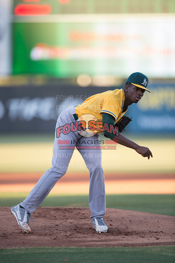 AZL Athletics starting pitcher Ismael Aquino (38) follows through on his delivery during an Arizona League game against the AZL Angels at Tempe Diablo Stadium on June 26, 2018 in Tempe, Arizona. The AZL Athletics defeated the AZL Angels 7-1. (Zachary Lucy/Four Seam Images)