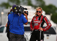 Apr 26, 2014; Baytown, TX, USA; NHRA funny car driver Courtney Force is interviewed by ESPN during qualifying for the Spring Nationals at Royal Purple Raceway. Mandatory Credit: Mark J. Rebilas-