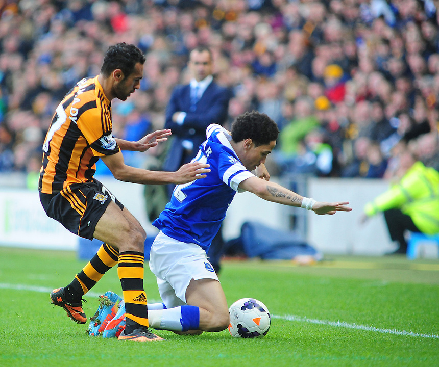 Everton's Steven Pienaar is tackled by Hull City's Ahmed Elmohamady<br /> <br /> Photographer Chris Vaughan/CameraSport<br /> <br /> Football - Barclays Premiership - Hull City v Everton - Sunday 11th May 2014 - Kingston Communications Stadium - Hull<br /> <br /> &copy; CameraSport - 43 Linden Ave. Countesthorpe. Leicester. England. LE8 5PG - Tel: +44 (0) 116 277 4147 - admin@camerasport.com - www.camerasport.com