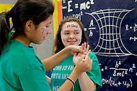 NWA Democrat-Gazette/DAVID GOTTSCHALK Guadalupe Rios (left) writes the symbol Pi on the hand of Natalie Prime, both eighth grade students at St. Vincent de Paul Catholic School,<br /> Wednesday, March 14, 2018, as they participate in Pi Day activities at the school in Rogers. Seventh and eighth grade students participated in five activities that featured  bracelet making, writing of Pi-Kus, and pie eating.