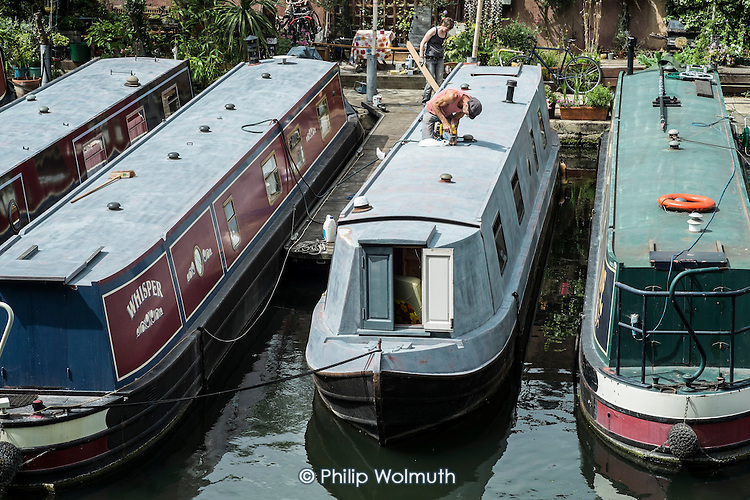 Houseboats on the Paddington branch of the Grand Union canal. The number of people living on London canals has risen sharply as a result of rising rents and property prices in the capital.