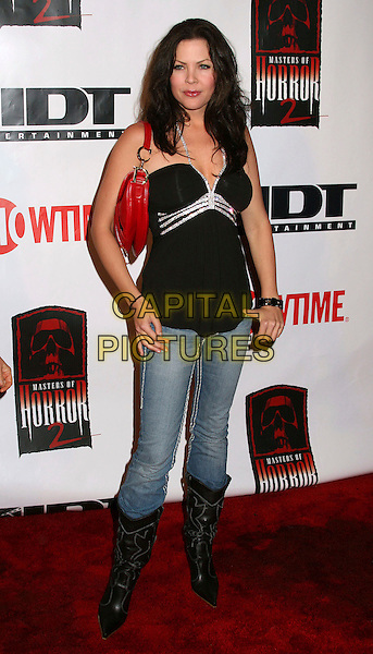 "CHRISTA CAMPBELL.""Masters Of Horror"" Season 2 Launch Party at The Iva, Hollywood, California, USA. .April 4th, 2006.Photo: Byron Purvis/AdMedia/Capital Pictures.Ref: BP/ADM.full length jeans denim tucked into black boots top.www.capitalpictures.com.sales@capitalpictures.com.© Capital Pictures."