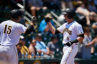 Bradenton Marauders right fielder Kevin Krause (6) is congratulated by John Bormann (15) after hitting a home run in the bottom of the second inning during a game against the Charlotte Stone Crabs on April 9, 2017 at LECOM Park in Bradenton, Florida.  Bradenton defeated Charlotte 5-0.  (Mike Janes/Four Seam Images)