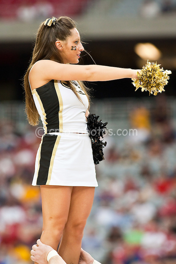 Mar 28, 2009; Glendale, AZ, USA; A Missouri Tigers Cheerleader in the second half of a game against the Connecticut Huskies in the finals of the west region of the 2009 NCAA basketball tournament at University of Phoenix Stadium.  The Huskies defeated the Tigers 82-75 to advance to the Final Four.
