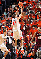 Virginia guard Joe Harris (12) is fouled by Virginia Tech guard Ben Emelogu (15) as he shoots the ball during the game Saturday in Charlottesville, VA. Photo/The Daily Progress/Andrew Shurtleff