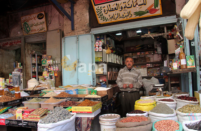 A Palestinian vendor stands in his store at al-Zawiya popular market in Gaza city, January 20, 2013. Photo by Ezz al-Zanoon
