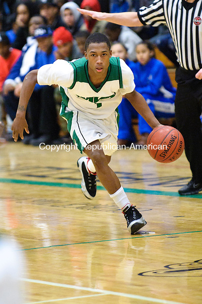 WATERBURY, CT - 14 January 2013-011413EC02--    Action man.  Wilby's Walter Wright against Crosby Monday night.  The Wildcats defeated the Bulldogs 83-82 in double overtime.  Erin Covey Republican-American.