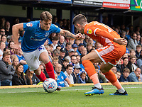 Shrewsbury Town's Alex Gilliead (right) battles with Portsmouth's Ben Thompson (left) <br /> <br /> Photographer David Horton/CameraSport<br /> <br /> The EFL Sky Bet League One - Portsmouth v Shrewsbury Town - Saturday September 8th 2018 - Fratton Park - Portsmouth<br /> <br /> World Copyright &copy; 2018 CameraSport. All rights reserved. 43 Linden Ave. Countesthorpe. Leicester. England. LE8 5PG - Tel: +44 (0) 116 277 4147 - admin@camerasport.com - www.camerasport.com