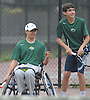 Nate Melnyk, left, and doubles partner Bobby Bellino of Harborfields get ready to switch sides on the court during their varsity boys tennis match against host Smithtown High School East on Tuesday, Apr. 29, 2016. Melnyk, a wheelchair-using junior, played in his first varsity match, which was suspended in the first set due to the inclement weather. The match is set to resume on Monday, May 2.