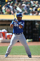 OAKLAND, CA - MAY 19:  Salvador Perez #13 of the Kansas City Royals bats during the game against the Oakland Athletics at O.co Coliseum on Sunday May 19, 2013 in Oakland, California. Photo by Brad Mangin
