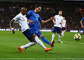 27th March 2018, Wembley Stadium, London, England; International Football Friendly, England versus Italy; Mattia De Sciglio of Italy puts pressure on Ashley Young of England