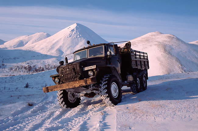 An Ural truck on a winter road in the Vanya Valley, Kolyma Mountain Range. Evensk. Magadan Region, Eastern Siberia, Russia.
