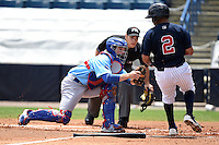 Daytona Cubs catcher Chadd Krist (16) tags out Cito Culver (2) attempting to score as umpire Jordan Albarado looks on to make the call during a game against the Tampa Yankees  on April 13, 2014 at George M. Steinbrenner Field in Tampa, Florida.  Tampa defeated Daytona 7-3.  (Mike Janes/Four Seam Images)
