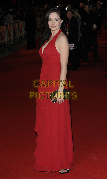 Anna Skellern.attending the 'I Give It A Year' European film premiere, Vue West End cinema, Leicester Square, London, England, UK, 24th January 2013..full length long maxi dress black clutch bag red cleavage low cut halterneck side .CAP/CAN.©Can Nguyen/Capital Pictures.
