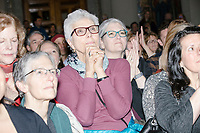 People listen as Democratic presidential candidate Pete Buttigieg speaks at a campaign event at the Currier Museum of Art in Manchester, New Hampshire, USA, on Fri., Apr. 5, 2019. The venue was filled to capacity about an hour before the candidate's arrival, so Buttigieg delivered an impromptu speech to those denied entry outside the museum before the official event. Buttigieg is the mayor of South Bend, Indiana, and was widely considered a long-shot candidate until his appearance in a CNN town hall in March 2019 which catapulted his campaign to prominence and substantial donations.