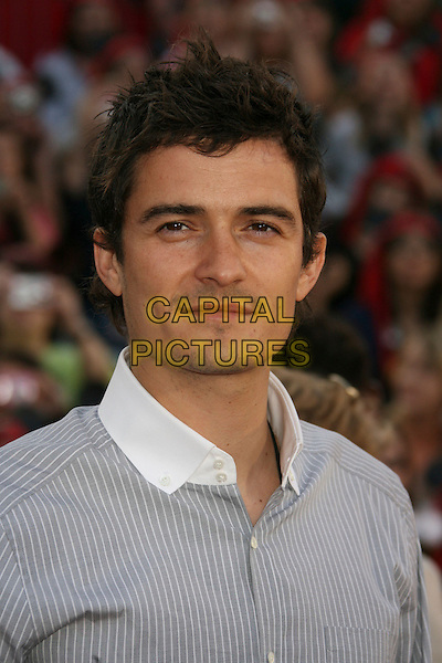 "ORLANDO BLOOM.""Pirates Of The Caribbean: At World's End"" World Premiere held at Disneyland, Anaheim, California, USA,.May 19th, 007.3 headshot portrait white collar grey gray pinstripe.CAP/ADM/RE.©Russ Elliot/AdMedia/Capital Pictureso"