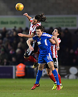 Lincoln City's Michael Bostwick beats Notts County's Matty Virtue to a high ball<br /> <br /> Photographer Chris Vaughan/CameraSport<br /> <br /> The EFL Sky Bet League Two - Lincoln City v Notts County - Saturday 13th January 2018 - Sincil Bank - Lincoln<br /> <br /> World Copyright &copy; 2018 CameraSport. All rights reserved. 43 Linden Ave. Countesthorpe. Leicester. England. LE8 5PG - Tel: +44 (0) 116 277 4147 - admin@camerasport.com - www.camerasport.com