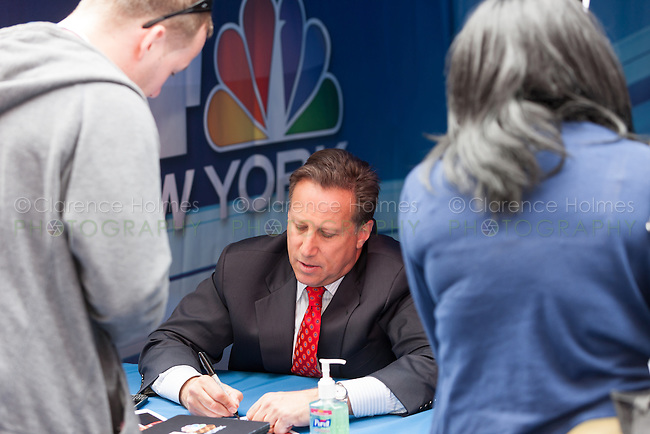 WNBC TV4 sports anchor Bruce Beck signs autographs at the Road to London 100 Days Out Celebration in Times Square in New York City, New York, USA on Wednesday, April 18, 2012.  Times Square was transformed into an Olympic Village for the event.