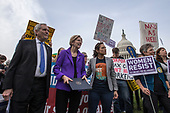 United States Representative Lloyd Doggett (Democrat of Texas), left, United States Senator Elizabeth Warren (Democrat of Massachusetts), center, and progressive activist Nicole Gill, right, wait to speak during a rally led by Congressional Democrats against United States President Donald J. Trump's proposed tax plan outside the United States Capitol in Washington, D.C. on November 1st, 2017.<br /> Credit: Alex Edelman / CNP