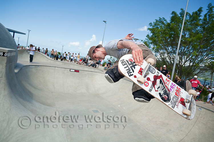 Skateboarder performing trick at skate park.  Cairns, Queensland, Australia