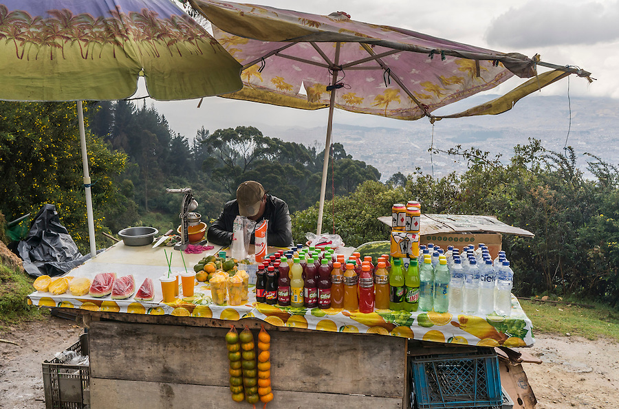 A street vendor asleep in his chair along the popular trail to the top of Cerro Monserrate in Bogota, Colombia.