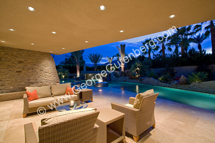Night Time Outdoor Sitting Area Of Patio With Large Pool