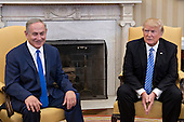 U.S. President Donald Trump, right, sits with Benjamin Netanyahu, Israel's prime minister, in the Oval Office of the White House in Washington, D.C., U.S., on Wednesday, Feb. 15, 2017. Netanyahu is trying to recalibrate ties with Israel's top ally after eight years of high-profile clashes with former President Barack Obama, in part over Israel's policies toward the Palestinians. <br /> Credit: Andrew Harrer / Pool via CNP