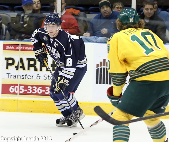 SIOUX FALLS, SD - JANUARY 17:  Dennis Kravchenko #18 from the Sioux Falls Stampede looks to make a pass as Jared Thomas #10 from the Sioux City Musketeers defends in the first period Friday night at the Sioux Falls Arena. (Photo by Dave Eggen/Inertia)