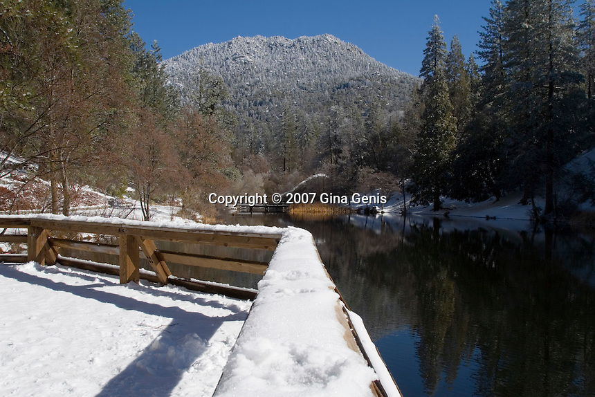 Snow covered pier at Lake Fulmor in the San Jacinto mountains of Southern California