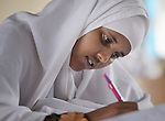 A girl takes an exam in the Waberi Secondary School in the Hagadera refugee camp, part of the Dadaab refugee complex in northeastern Kenya.
