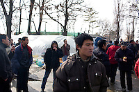 ROMANIA / Bucharest / 21.02.09..Hundreds of Chinese immigrants are currently stuck in Romania after their work contracts with construction firms here were suddenly terminated in late January. They expected to make at least 800 Euros per month, or double what they can make in China as agricultural laborers. About 80 of them are camped out under plastic sheeting in front of the Chinese Embassy hoping to get some kind of help. During the day, hundreds more are joining them to stage a protest. They paid a Chinese broker 10,000 Euros a piece for the lucrative four year construction contracts and are hoping to get reimbursed in order to be able to buy tickets home. The immigrants are relying upon the help of generous Romanians who pull up and deliver food from their cars. The economic crisis hit Romania just as many of the immigrants arrived in November. ...© Davin Ellicson / Anzenberger