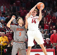 NWA Democrat-Gazette/J.T. WAMPLER Arkansas' J.T. Plummer keeps the ball away from Bucknell's Jordan Sechan Sunday Nov. 12, 2017 at Bud Walton Arena in Fayetteville. Arkansas won 101-73 and takes on Fresno State Friday at home.